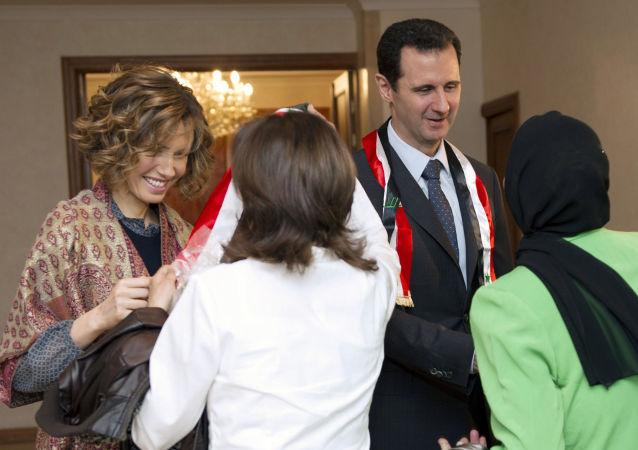الرئيس السوري بشار الأسد وزوجته أسماء الأسد