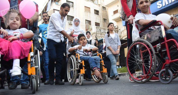 ذوو الاحتياجات الخاصة يحتفون باستعادة قلعة الذاكرة الرياضية لسوريا وأعرق ملاعبها