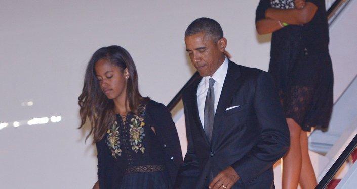 باراك أوباما وابنته ماليا