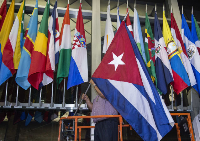 رفع العلم الكوبي على مدخل وزارة الخارجية الأمريكية