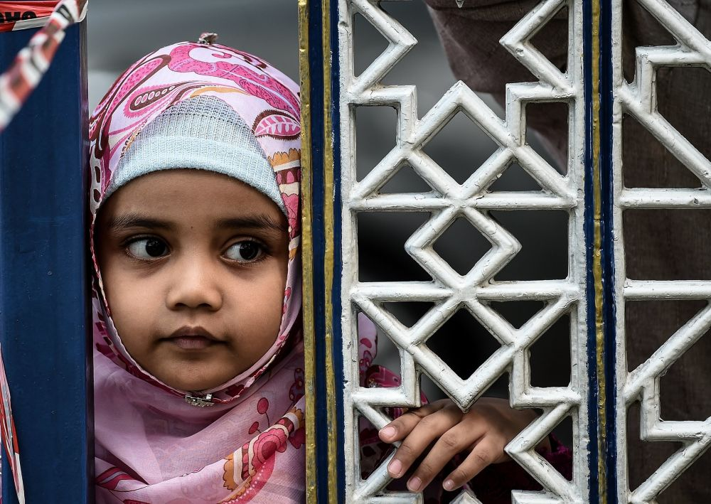 فتاة مسلمة خلال عيد الأضحى المبارك في ماليزيا