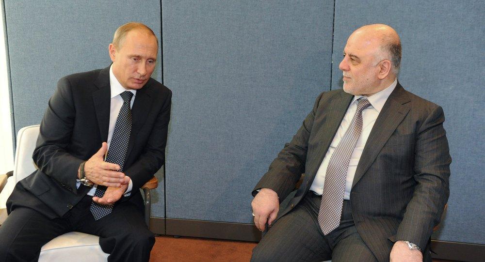 الرئيس فلاديمير بوتين يتحدث لرئيس الوزراء العراقي حيدر العبادي