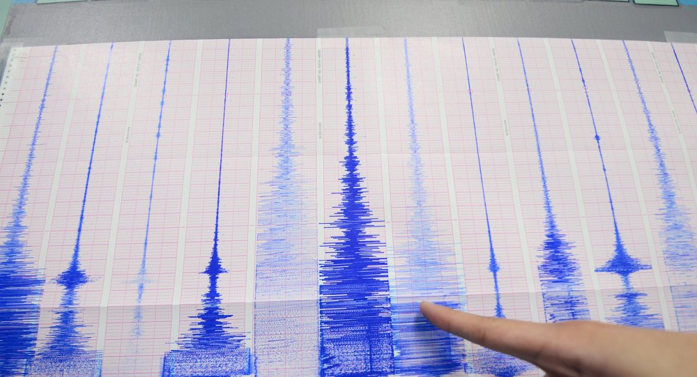 A staff member of the Seismology Center points to a chart showing the earthquake activity detected by the central Weather Bureau in Taipei on April 20, 2015