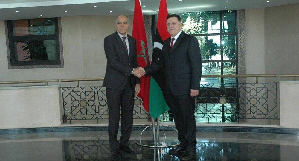 السراج مع وزير الخارجية المغربي صلاح مزوار