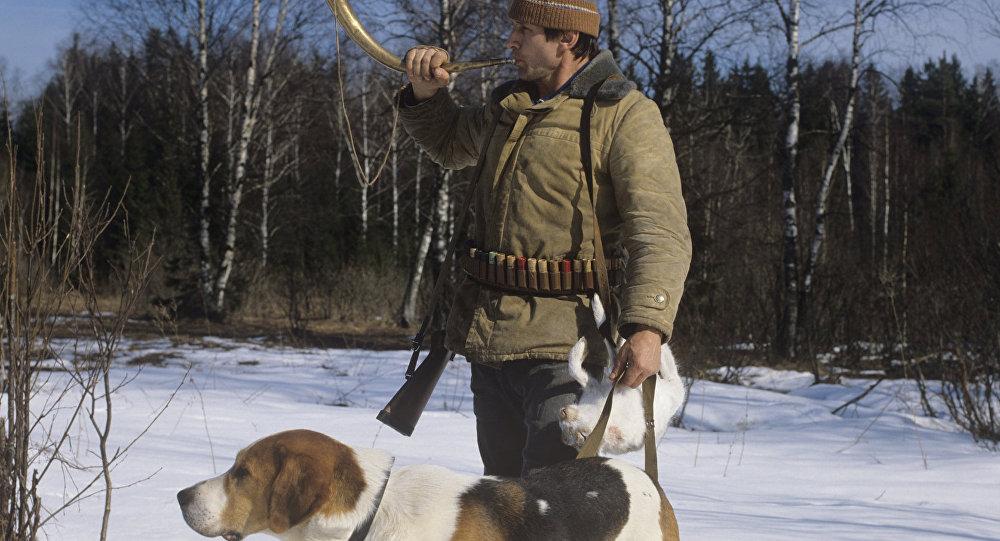 صياد وكلبه
