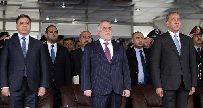 وزير الداخلية العراقية محمد غبان، رئيس الوزراء العراقي حيدر العبادي، وزير الدفاع العراقي خالد العبيدي.