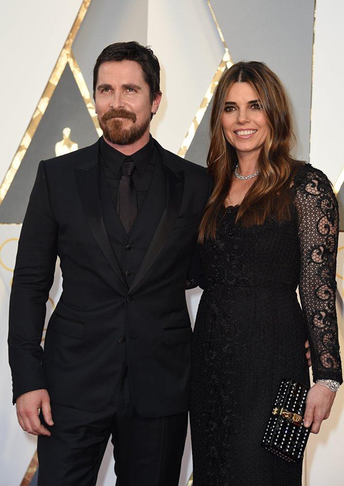 الممثل كريستيان بيل وزوجته سيبي بلازك عند حضورهم الحفل الـ88 لتوزيع جوائز أوسكار، 28 فبراير/ شباط 2016.