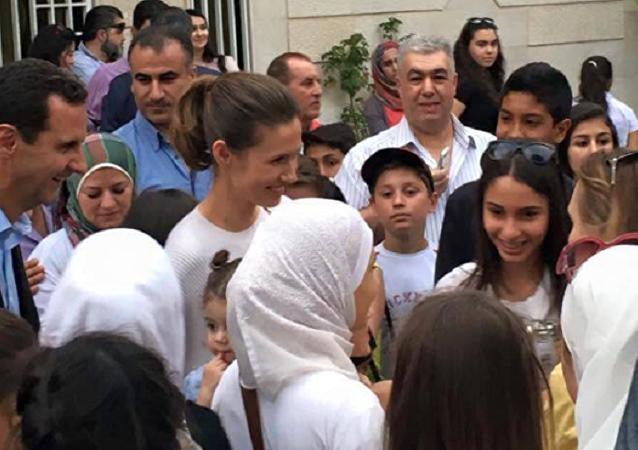 صورة مع الرئيس السوري بشار الأسد