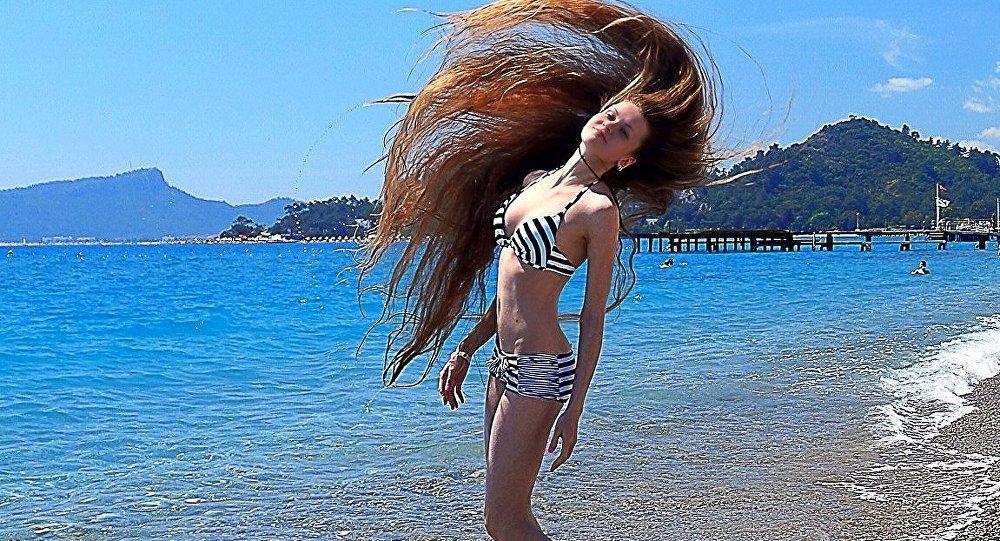 امرأة روسية تمتلك أطول شعر فى العالم