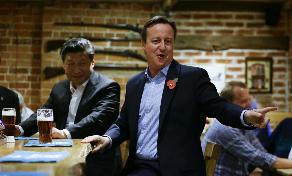 رئيس الوزراء البريطاني ديفيد كاميرون والرئيس الصيني شي جين بينغ، عام 2015