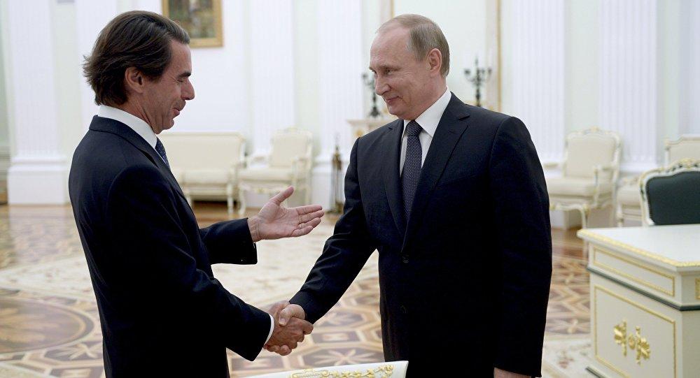 فلاديمسر بوتين ورئيس الوزراء الإسباني السابق