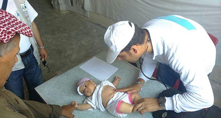 معاينة أطفال حلب المهجرين