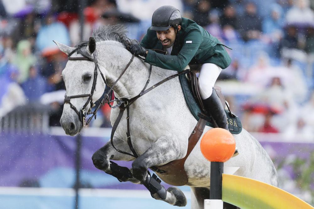 الأمير عبدالله آل سعود يركب حصانه دافوس (Davos )، خلال الألعاب الأولمبية الصيفية في لندن، 2012