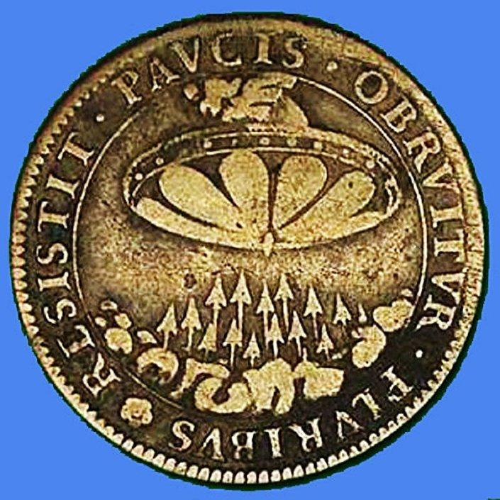Альт: يظهر على بعض القطع النقدية التي عثر عليها في إحدى البلدات المصرية نقش لصور رجل فضائي برأس أصلع، بالإضافة إلى نقوش لمركبات فضائية.