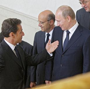 بوتين وساركوزي