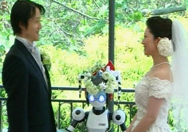 Robot marries bride and groom