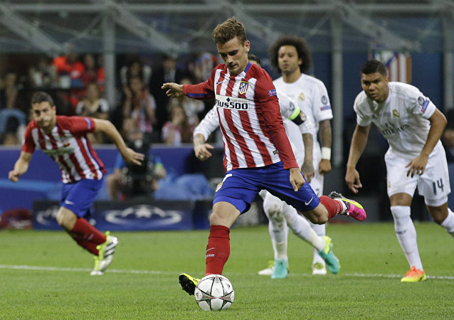 Atletico's Antoine Griezmann misses a penalty kick during the Champions League final soccer match between Real Madrid and Atletico Madrid at the San Siro stadium in Milan, Italy, Saturday, May 28, 2016