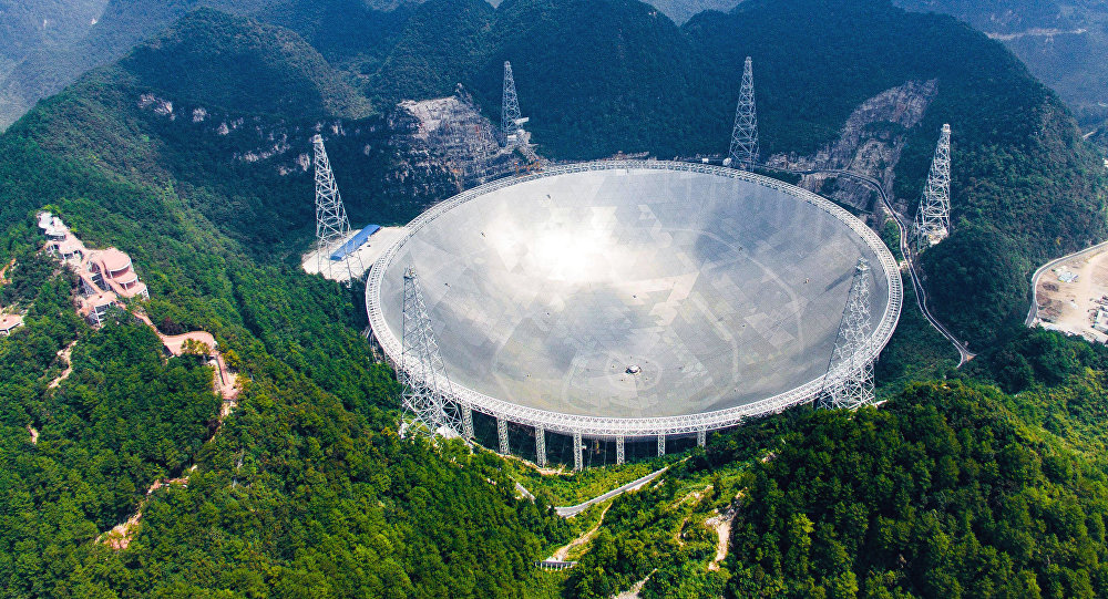 In this Saturday, Sept. 24, 2016 photo released by Xinhua News Agency, an aerial view shows the Five-hundred-meter Aperture Spherical Telescope (FAST) in the remote Pingtang county in southwest China's Guizhou province