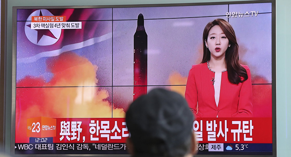 A man watches a TV news program reporting about North Korea's missile launch at the Seoul Train Station in Seoul, South Korea, Sunday, Feb. 12, 2017