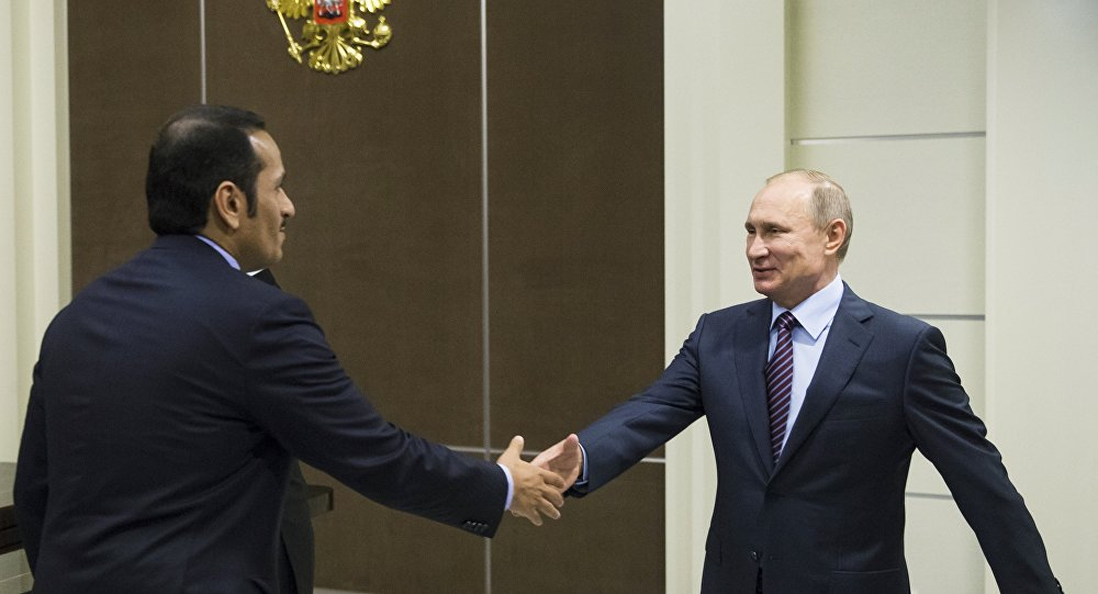 Russian President Vladimir Putin, right, shakes hands with Qatar Foreign Minister Mohammed bin Abdulrahman bin Jassim Al-Thani before their meeting in Sochi, Russia, Friday, May 6, 2016