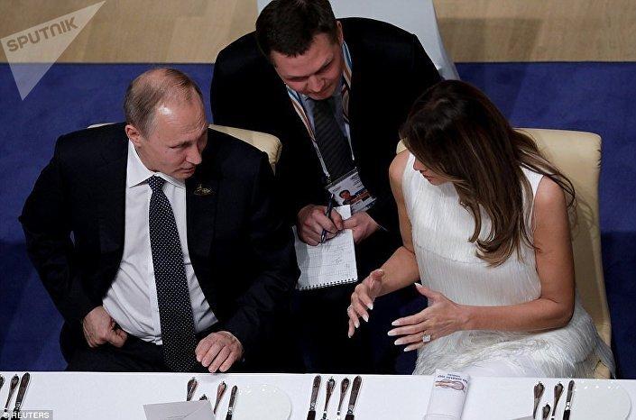 ميلانيا و بوتين خلال حفل عشاء قمة العشرين