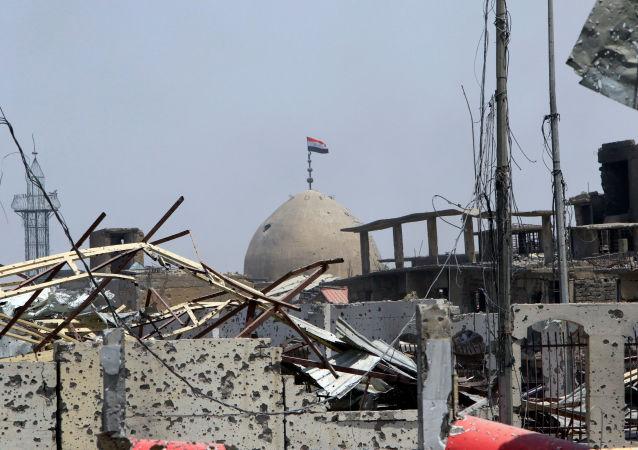 العلم العراقي في مدينة الموصل، العراق 9 يوليو/ تموز 2017