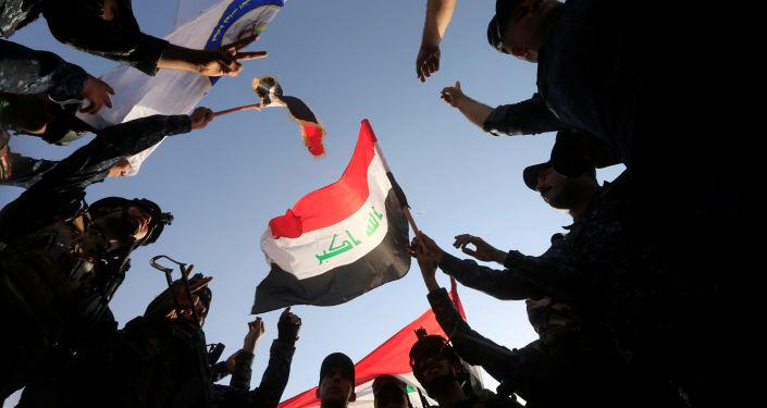 الشرطة العراقية تحتفل بتحرير الموصل، العراق 9 يوليو/ تموز 2017