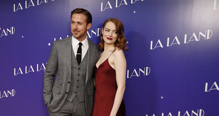 Actors Ryan Gosling and Emma Stone pose for photographers upon arrival at the screening of the film 'La La Land' in London, Thursday, Jan. 12, 2017.