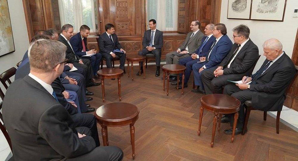 بشار الأسد ووفد روسي