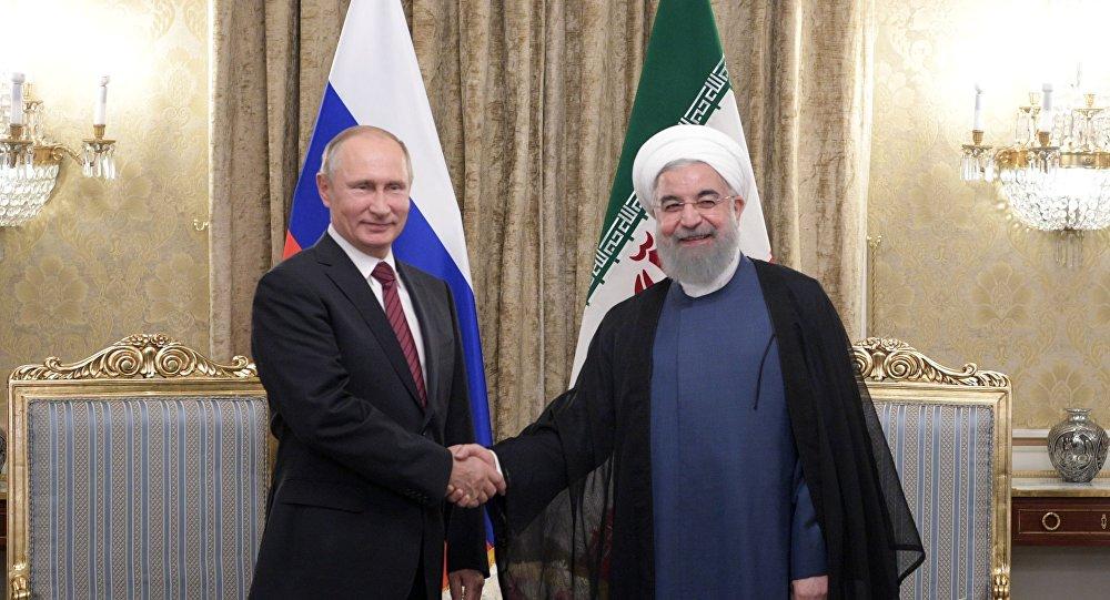 لقاء بوتين وروحاني