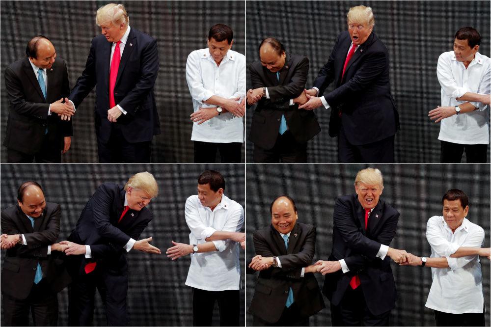 الرئيس الأمريكي دونالد ترامب خلال المصافحة مع زعماء العالم في قمة إبيك في الفيتنام، 13 نوفمبر/ تشرين الثاني 2017