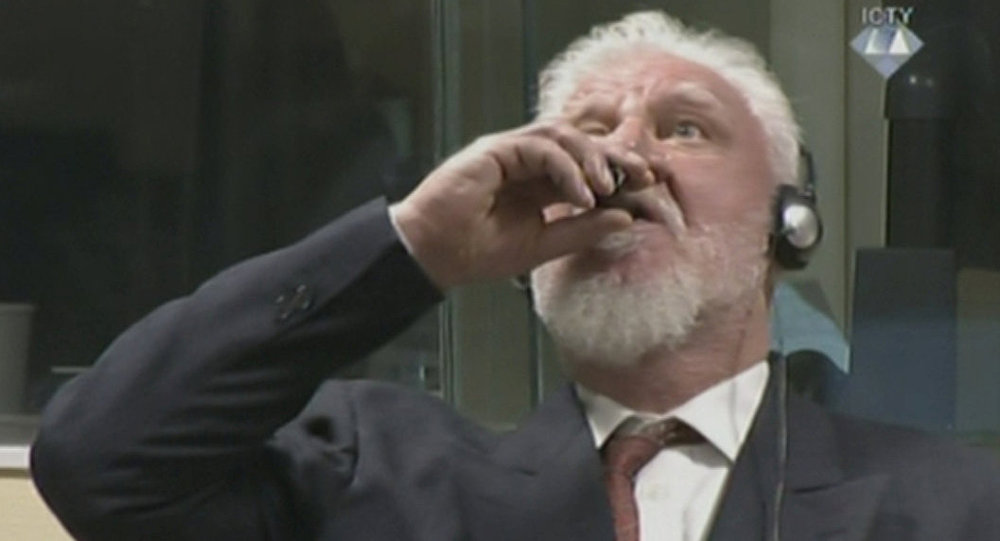 A wartime commander of Bosnian Croat forces, Slobodan Praljak, is seen during a hearing at the U.N. war crimes tribunal in the Hague, Netherlands, November 29, 2017