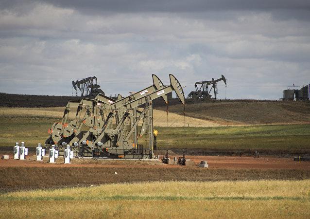 Pump jacks are seen on the Bakken Shale Formation, near Williston, North Dakota, on September 6, 2016