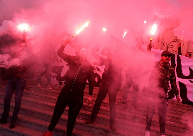 متظاهرون فى العاصمة تونس، 14 يناير/ كانون الثاني
