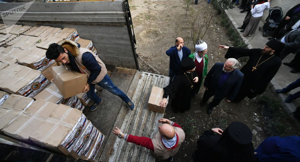 A delegation of religious figures in Russia is visiting Damascus - distributing humanitarian aid