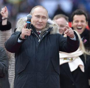 مرشح للانتخابات الرئاسية الروسية لعام 2018 فلاديمير بوتين خلال تظاهرة بعنوان من أجل روسيا قوية! في ملعب لوجنيكي بموسكو، 3 مارس/ أذار 2018