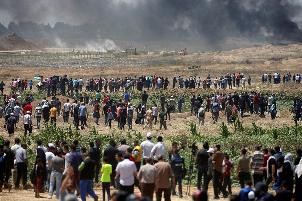 احتجاجات تعم البلاد ضد نقل السفارة الأمريكية إلى القدس عشية الذكرى الـ 70 للنكبة ، شرق غزة، قطاع غزة، فلسطين 14 مايو/ أيار 2018