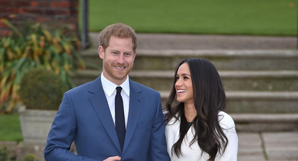 نجل ولي عهد بريطانيا الأمير هاري مع خطيبته الممثلة الأمريكية ميغان ماركل