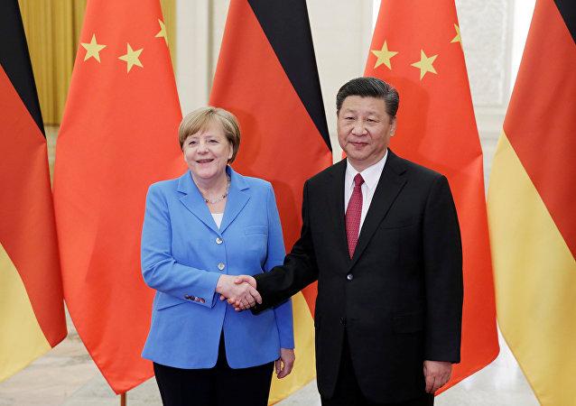 اتفق الرئيس الصيني شى جين بينغ والمستشارة الألمانية أنجيلا ميركل