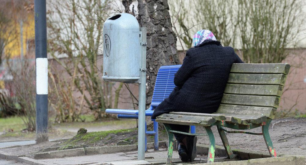 امرأة لاجئة