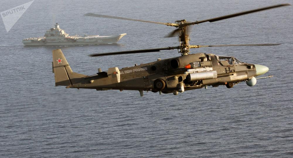 المروحية كا-52 كا والطراد الحمل للطائرات الأميرا لكوزنيتسوف في البحر المتوسط