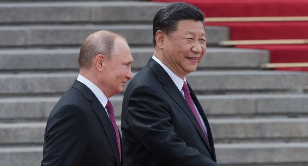 الرئيسان الروسي فلاديمير بوتين والصيني شي جين بينغ في الصين