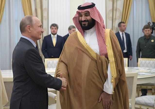 بوتين خلال لقائه ولي العهد السعودي محمد بن سلمان