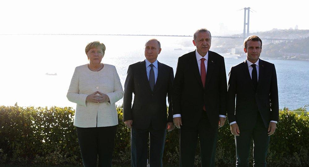 ماكرون أردوغان بوتين ميركل خلال القمة الرباعية حول سوريا
