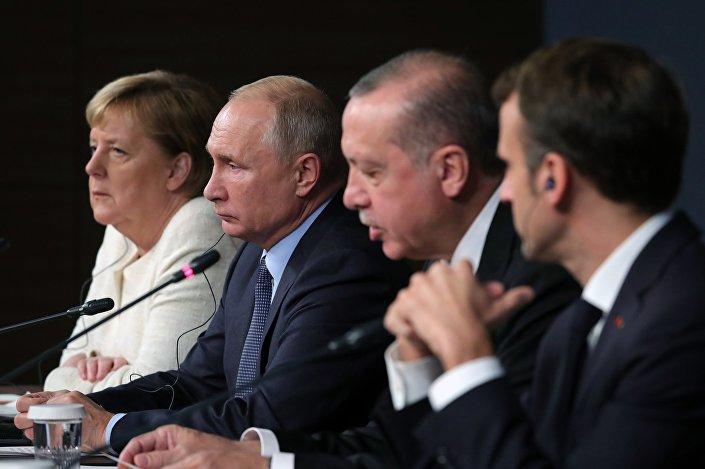 المباحثات الروسية الألمانية التركية الفرنسية حول حل الأزمة السورية وإعادة إعمار سوريا
