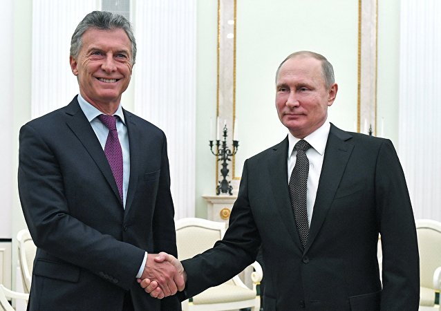 الرئيس الروسي، فلاديمير بوتين، ونظيره الأرجنتيني، ماوريسيو ماركي