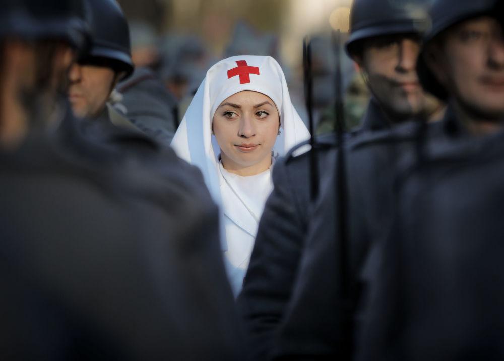 المشاركون في العرض العسكري في بوخارست بمناسبة للاحتفال بالذكرى المئوية لقيام دولة رومانيا، 1 ديسمبر/ كانون الأول 2018