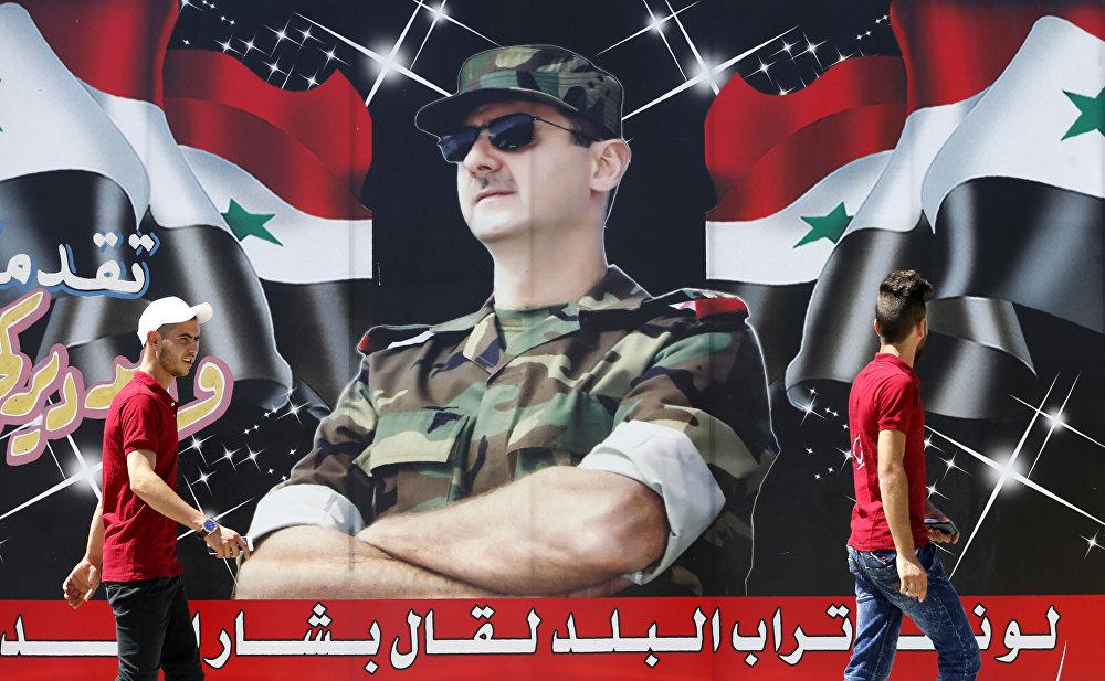 لافتة للرئيس السوري بشار الأسد في شارع وسط العصمة دمشق، 9 يوليو/ تموز 2018
