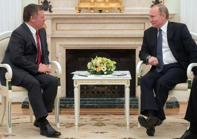 الرئيس الروسي فلاديمير بوتين وملك الأردن
