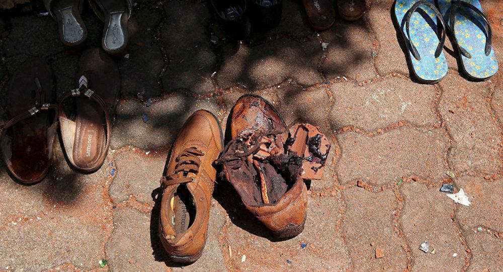 الدماء على زوج من الأحذية في كنيسة القديس سيباستيان الكاثوليكية في نيجومبو